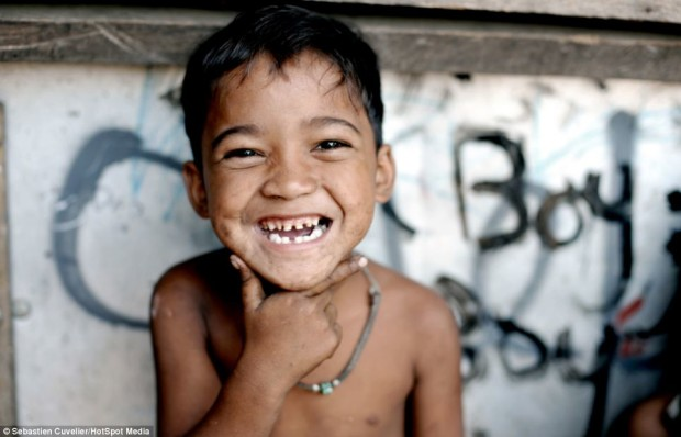 http://www.dailymail.co.uk/news/article-2725840/Hope-amid-squalor-The-smiling-children-Manila-slums-overcoming-filth-poverty-homes.html